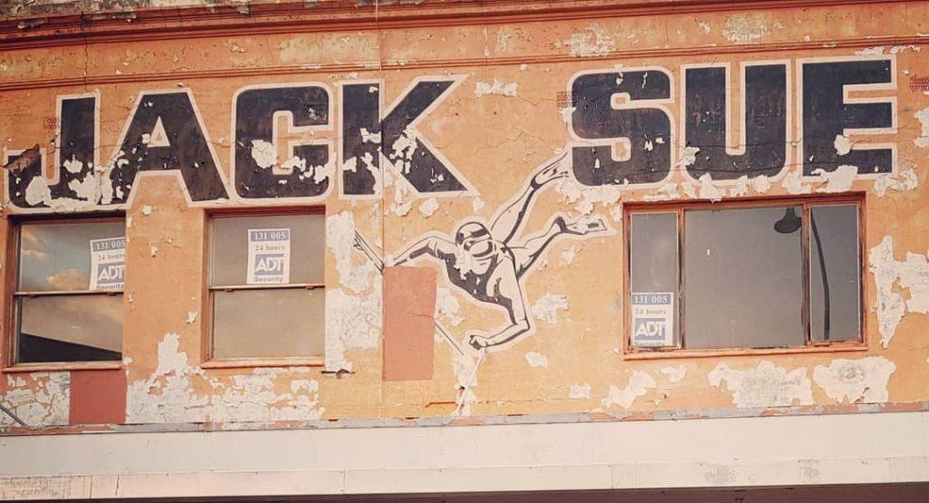 jack sue building sign
